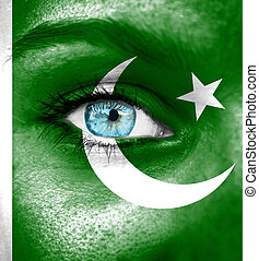 Woman face painted with flag of Pakistan