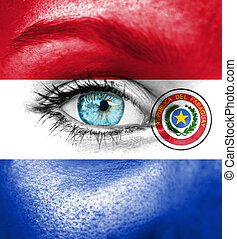 Woman face painted with flag of Paraguay