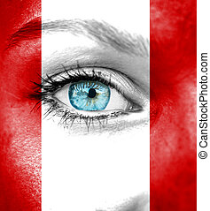 Woman face painted with flag of Peru