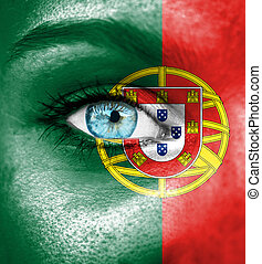 Woman face painted with flag of Portugal