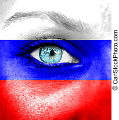 Woman face painted with flag of Russia