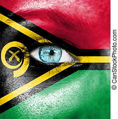 Woman face painted with flag of Vanuatu