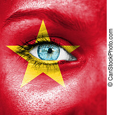Woman face painted with flag of Vietnam