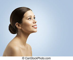 Woman Face Side View, Bun Hair, Fashion Model Beauty Makeup and Hairstyle over Blue