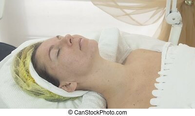Woman face with closed eyes in beauty saloon on cosmetic...