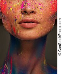 Woman face with creative make-up and body art