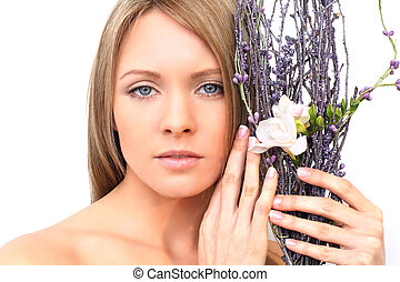 Woman face with flower - spring beauty concept