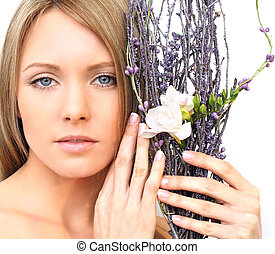 Woman face with flower - spring beauty