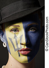 Woman face with painted flag of Barbados