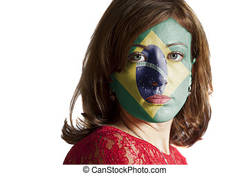 Woman face with painted Flag of Brazil