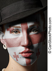 Woman face with painted Flag of Georgia