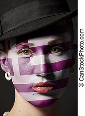 Woman face with painted Flag of Greece