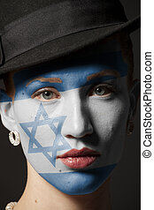 Woman face with painted Flag of Israel