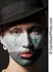 Woman face with painted Flag of Syria