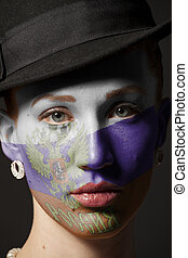 Woman face with painted Flag of the Russian Federation