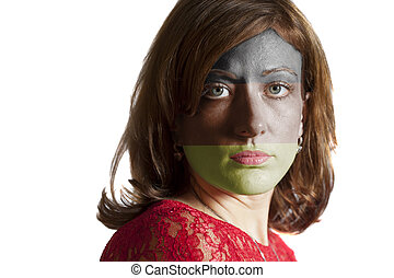 Woman face with painted German flag