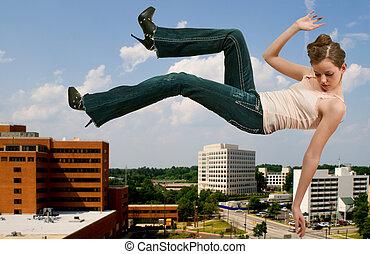 Woman Falling Through the Sky - A beautiful young teenage...