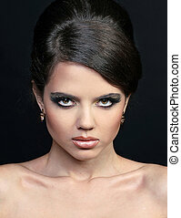 Woman fashion face make-up. Jewelry and Beauty.