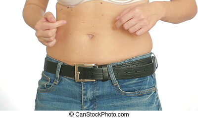 Woman fat belly. Overweight and weight loss concept. girl pulls the stomach
