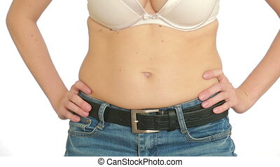 Woman fat belly. vacuum massage of the abdomen. girl pulls the stomach