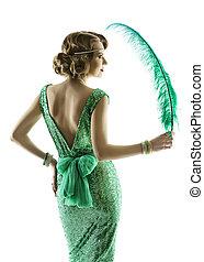 Woman feather portrait in fashion retro sequin dress, luxury...