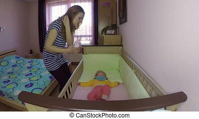 woman feed baby bottle