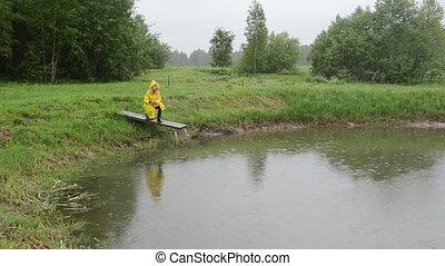 woman feed fish rain