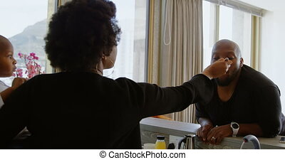 Woman feeding food to her husband in a comfortable home 4k