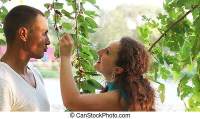 Woman feeding her boyfriend berries