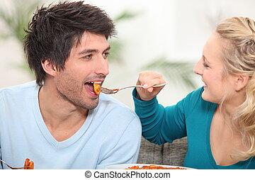 Woman feeding her husband food