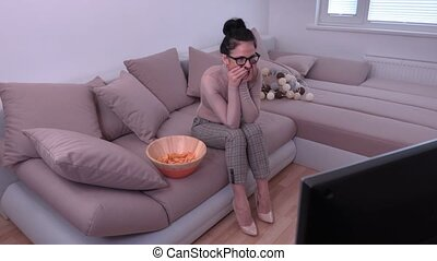 Woman feel ashamed when watching TV