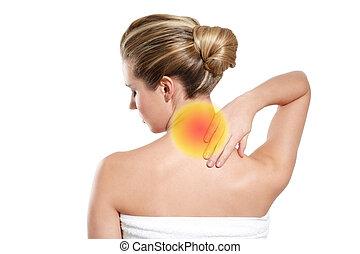 woman feeling backache - a young woman feeling backace on...