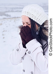 woman feeling cold in the snow