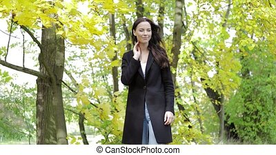 Woman feeling cold - Attractive sad woman in black jacket...