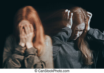 Woman feeling emotional pain, covering face, having headache