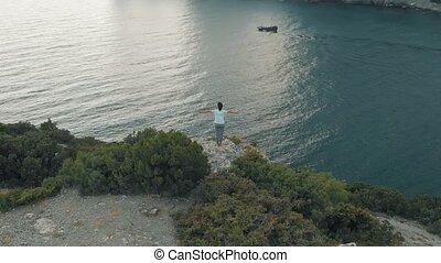 Woman feeling freedom aerial view