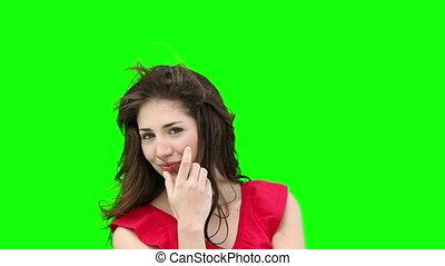 Woman feeling her hair as it is blown by the wind