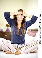 Woman feeling very strong headache sad