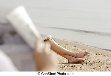 Woman feet in sand on the beach