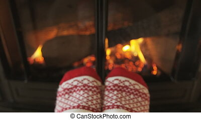 Woman Feet In Socks Relaxing Near Fireplace Getting Warm and...