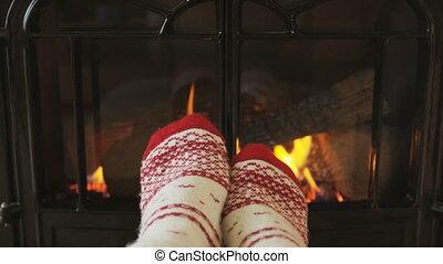 Woman Feet In Socks Relaxing Warming by Fireplace Getting ...