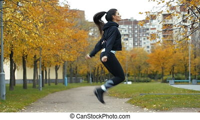 Woman feet jumping, using skipping rope in park.