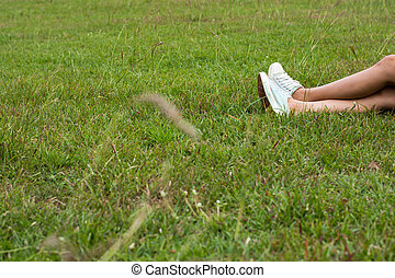 Woman feet on grass.