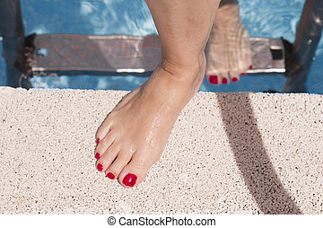 Woman feet out of the pool