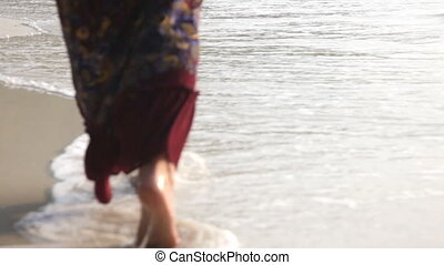 Woman feet walking on the beach