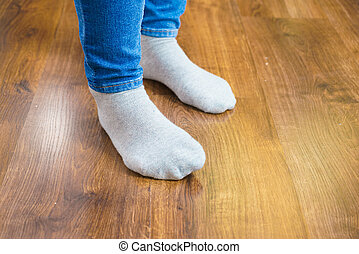 Woman feet wearing socks and jeans trousers - Woman feet...