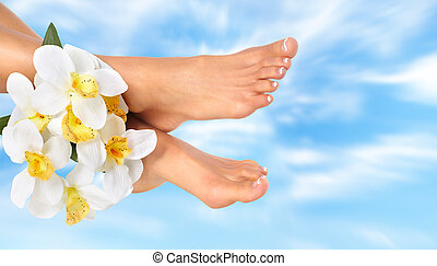 Woman feet with flower.