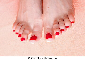 woman feet with red toenails on towel - woman feet with red ...