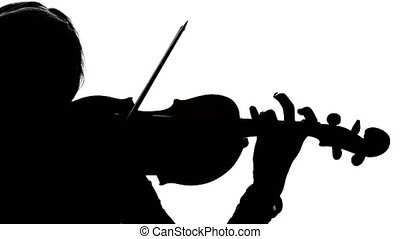 Woman fiddler playing the viola. Close-up. Silhouette -...