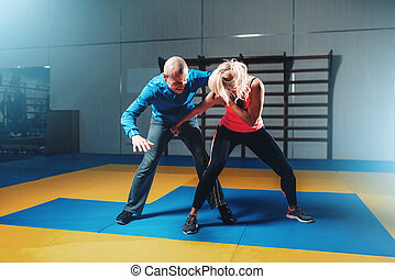 Woman fights with man, self defense technique